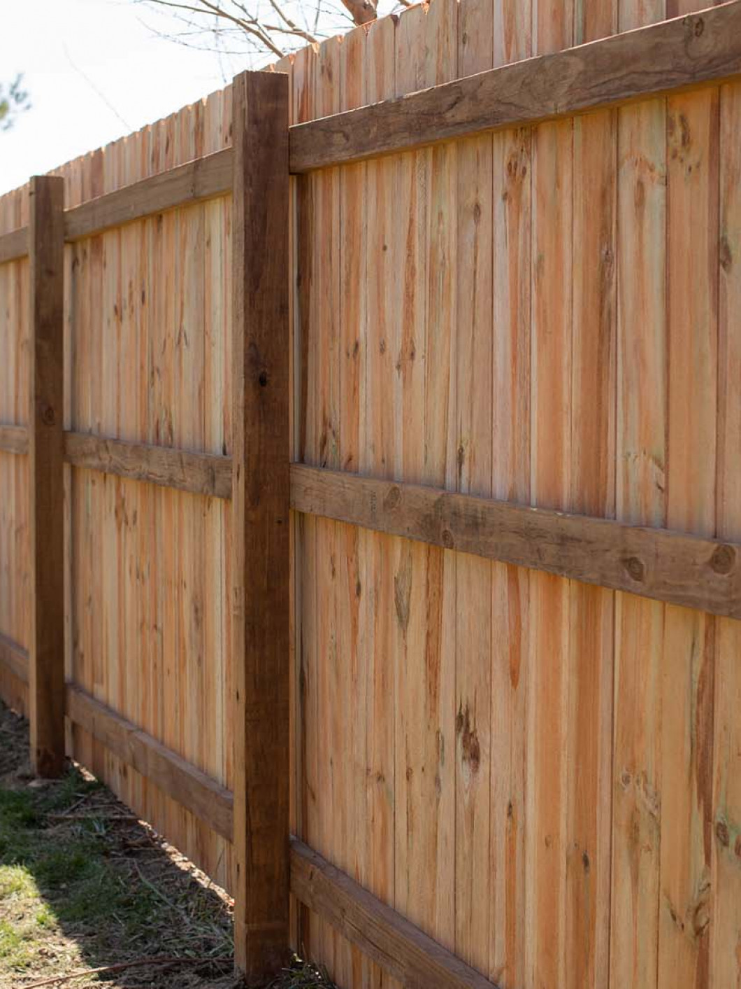 Wooden fence installed at a home with an opening in the middle section of the fence