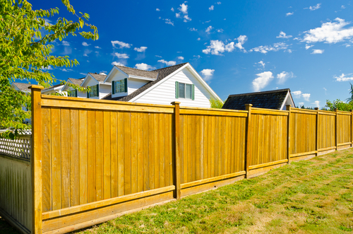 Topcap wooden fence installed in front of a house